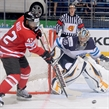 MINSK, BELARUS - MAY 22: Canada's Joel Ward #42 reaches for a loose puck in front of Finland's Pekka Rinne #35 during quarterfinal round action at the 2014 IIHF Ice Hockey World Championship. (Photo by Richard Wolowicz/HHOF-IIHF Images)